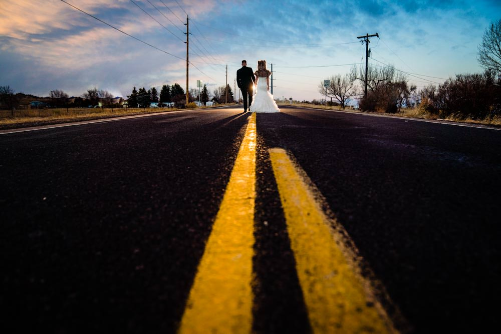 Bride and groom walking with animal hood - Tapestry House winter wedding by Fort Collins wedding photographer, JMGant Photography