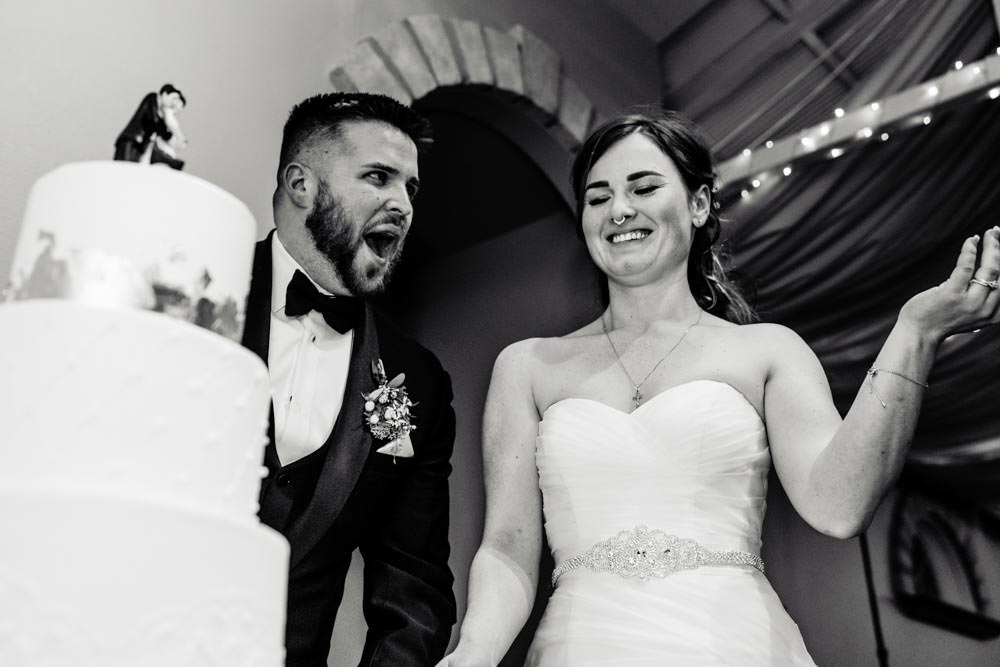 Cake cutting - Tapestry House winter wedding by Fort Collins wedding photographer, JMGant Photography