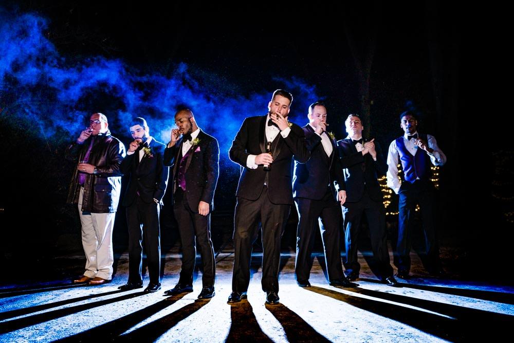 Groomsmen Cigar break - Tapestry House winter wedding by Fort Collins wedding photographer, JMGant Photography