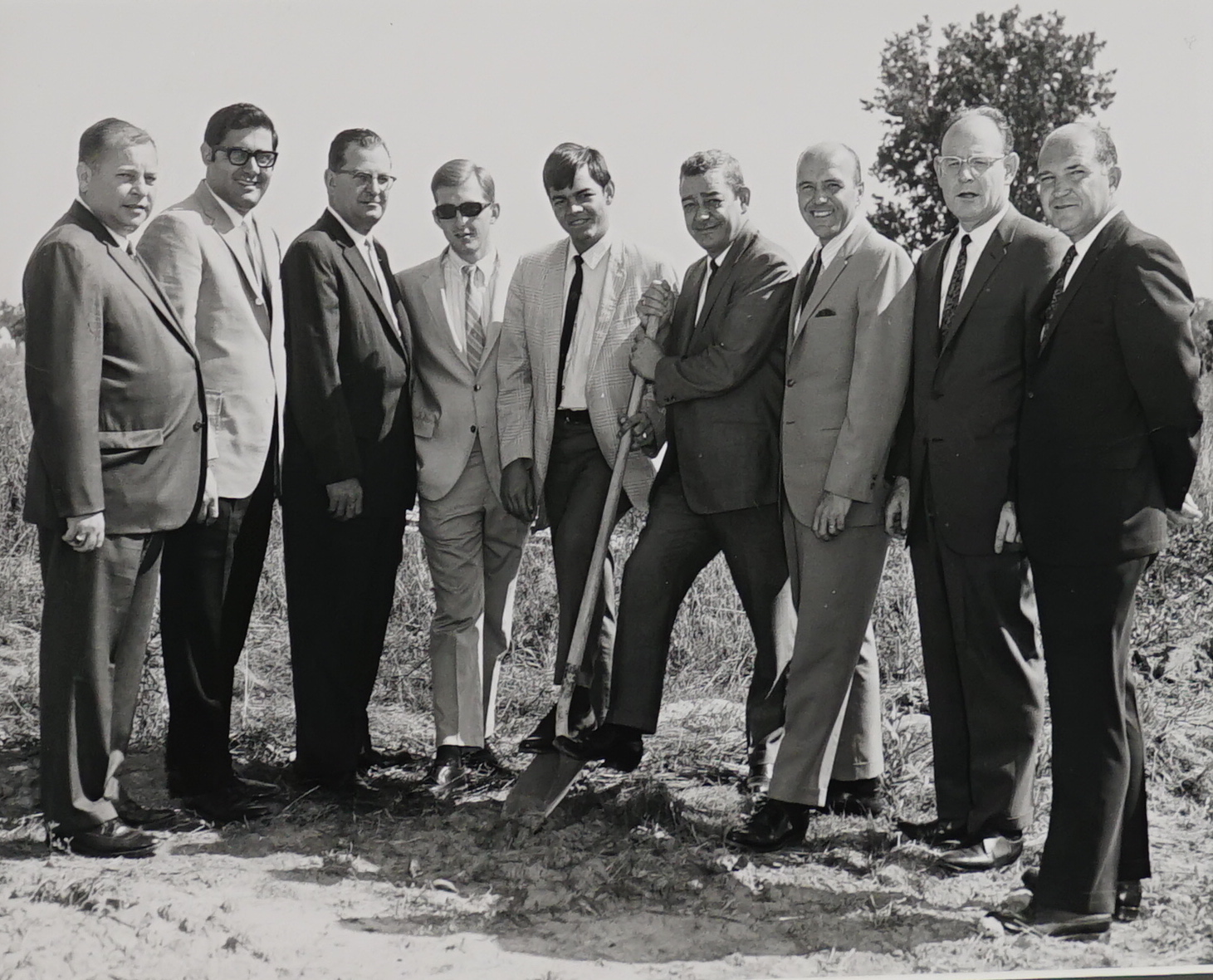 Miles Printing-1969 Ground Breaking Ceremony.  From left to right:  Doug Bolt, Bob Lutz (builder), Bob Ward, Gordon Jones, Rick Miles, Henry Miles, Ralph Dietz, Jerry Nieten, and Parvin (Benny) Benefiel.