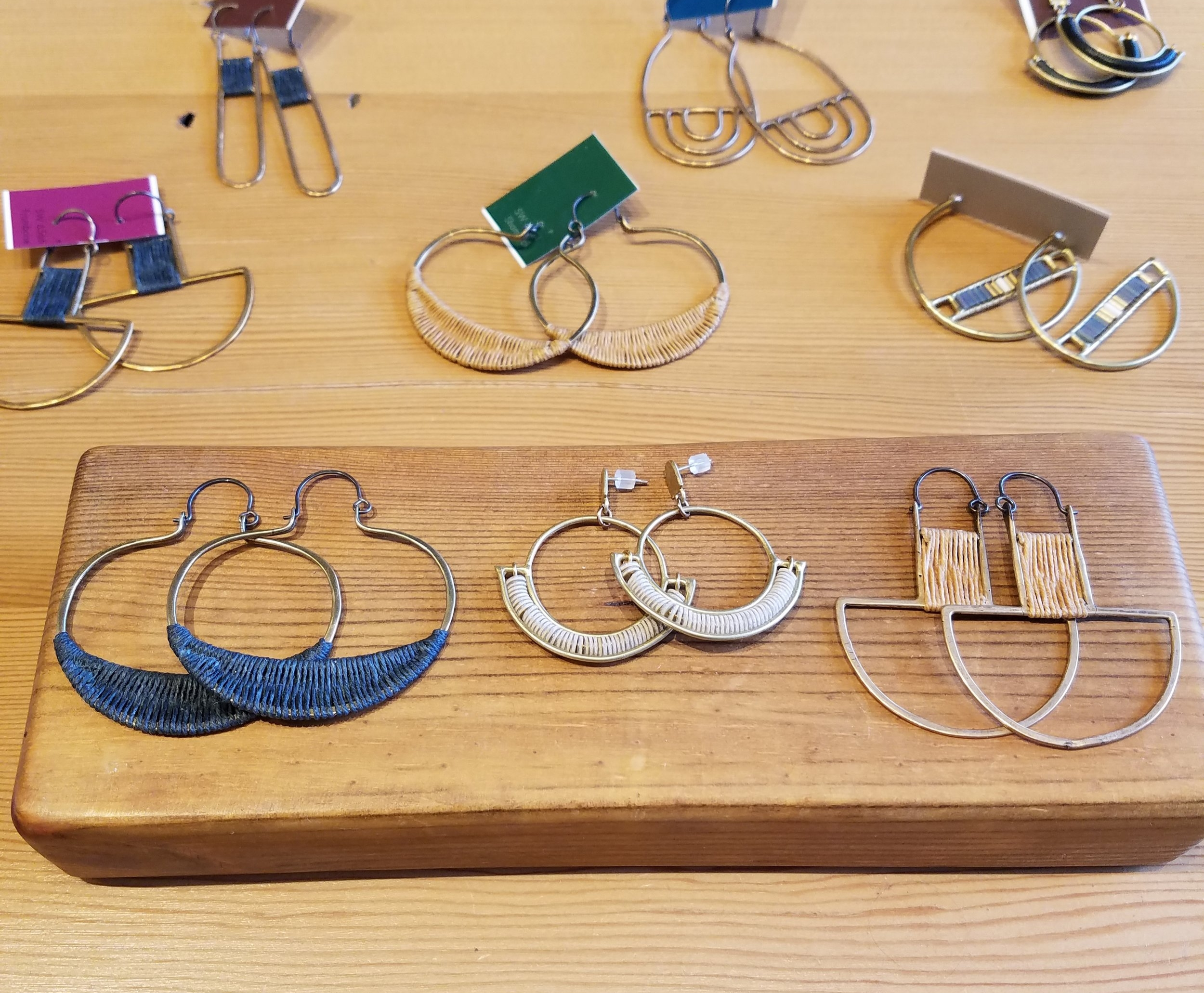 Jewelry is always a great stocking stuffer! We carry many different styles of earrings, rings, and necklaces in price ranges for any budget. *Earrings on wood block from L to R: $127, $90, $103