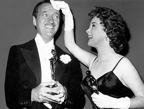 Tell it all: David Niven with Susan Hayworth in 1958