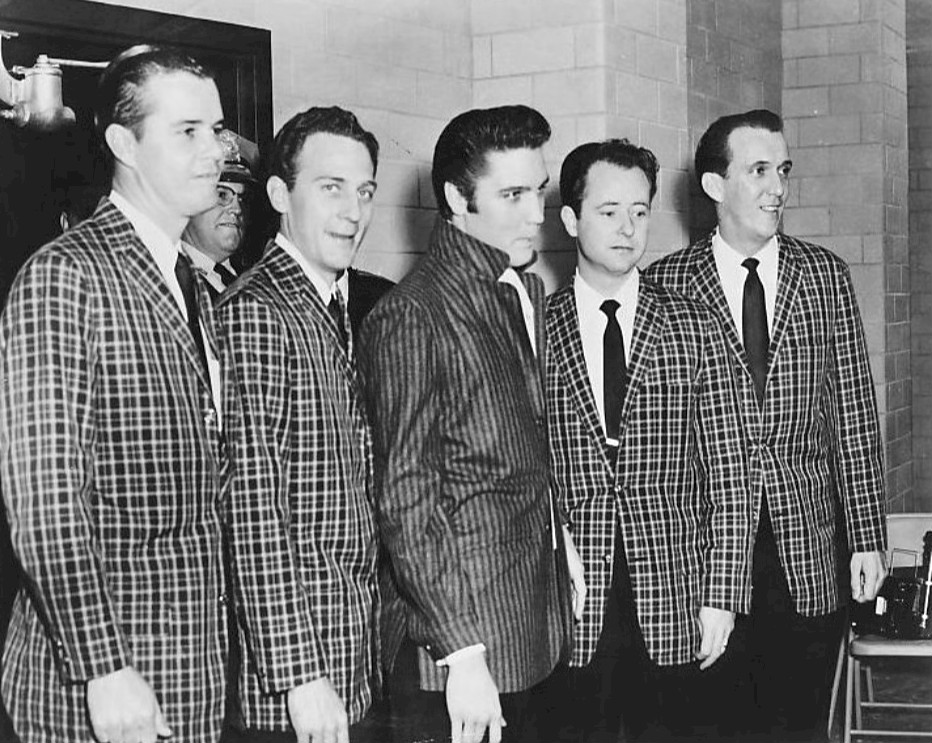 Collars up. collars down. Elvis Presley and the Jordanaires, 1957