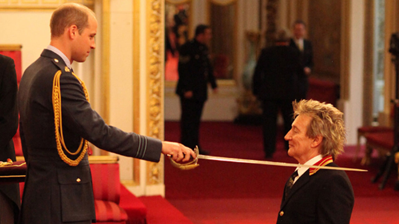 Arise Sir Rod? Mr Stewart gets the the nod, but here Prince William does the honours, not the Queen