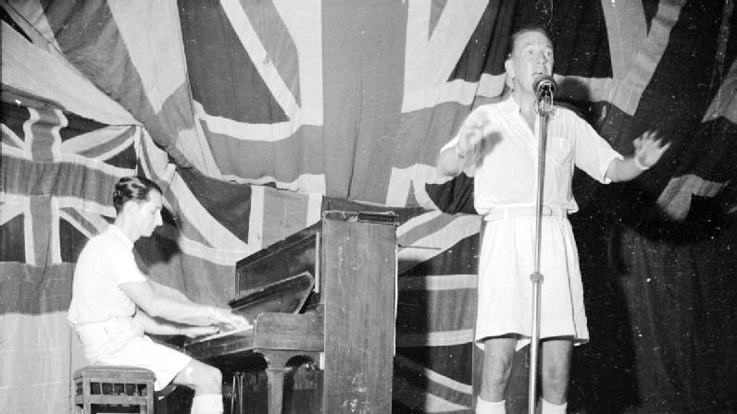 A tale of two Noels … Noel Coward wittily entertains the troops on HMS Victorious, 1944.