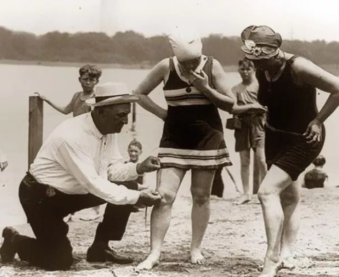 1920s swimmers are measured for the modesty of their bathing suits and face fines for showing too much leg
