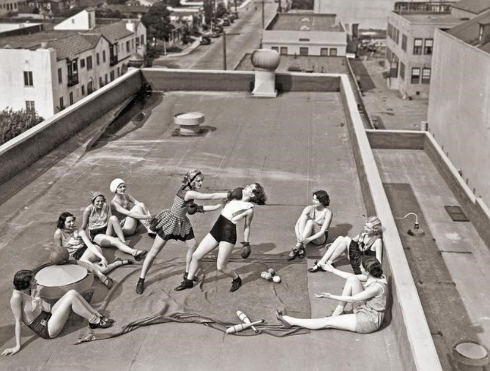 Female boxers train in secret on a roof, 1930s