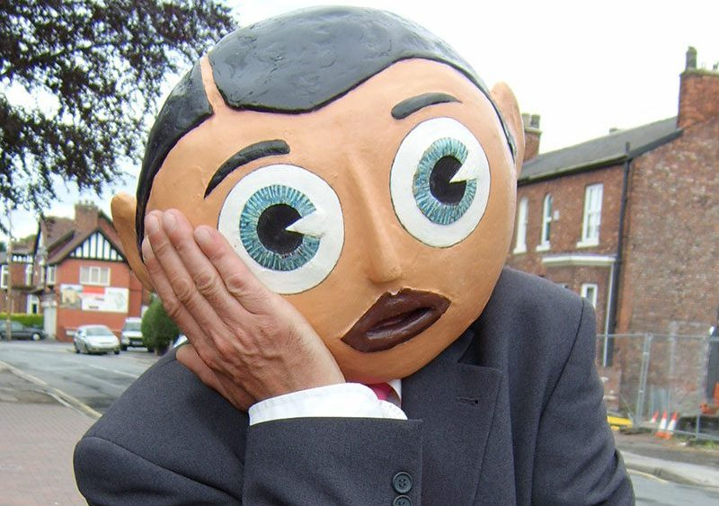 Frank Sidebottom aka Chris Sievey. Somehow giving both the appearance of sadness and happiness.