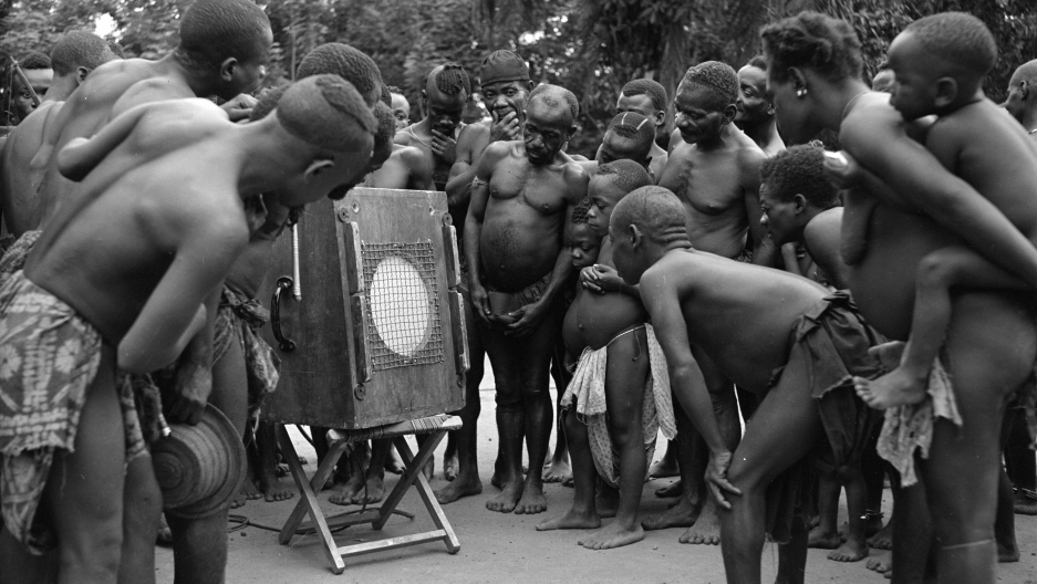 Mbuti pygmies listening back to their own music in 1952