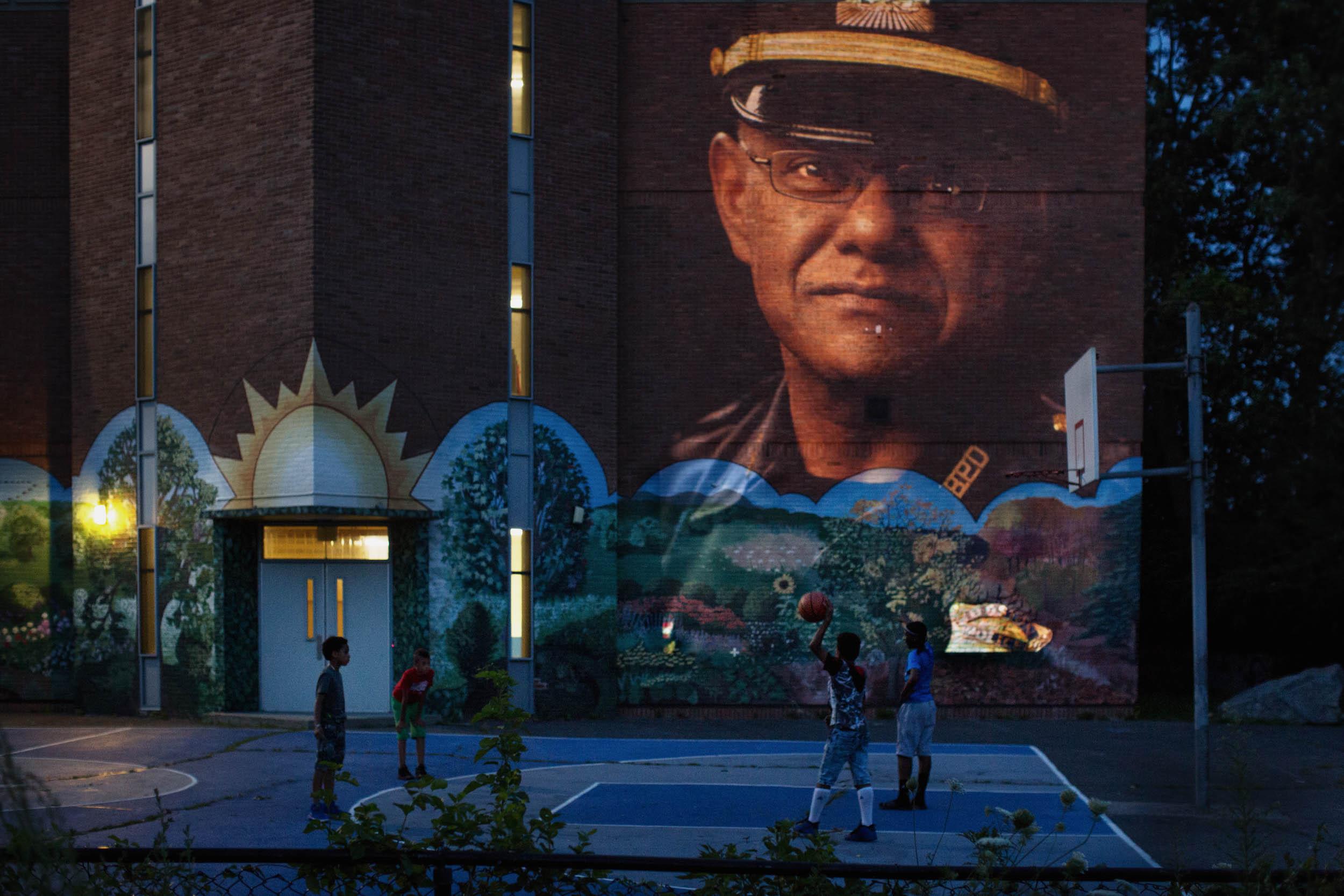 Haseeb Hosein | Trinidad Captain, Boston Police Department - Projected on the Lee School in the B-3 Police District where he works.