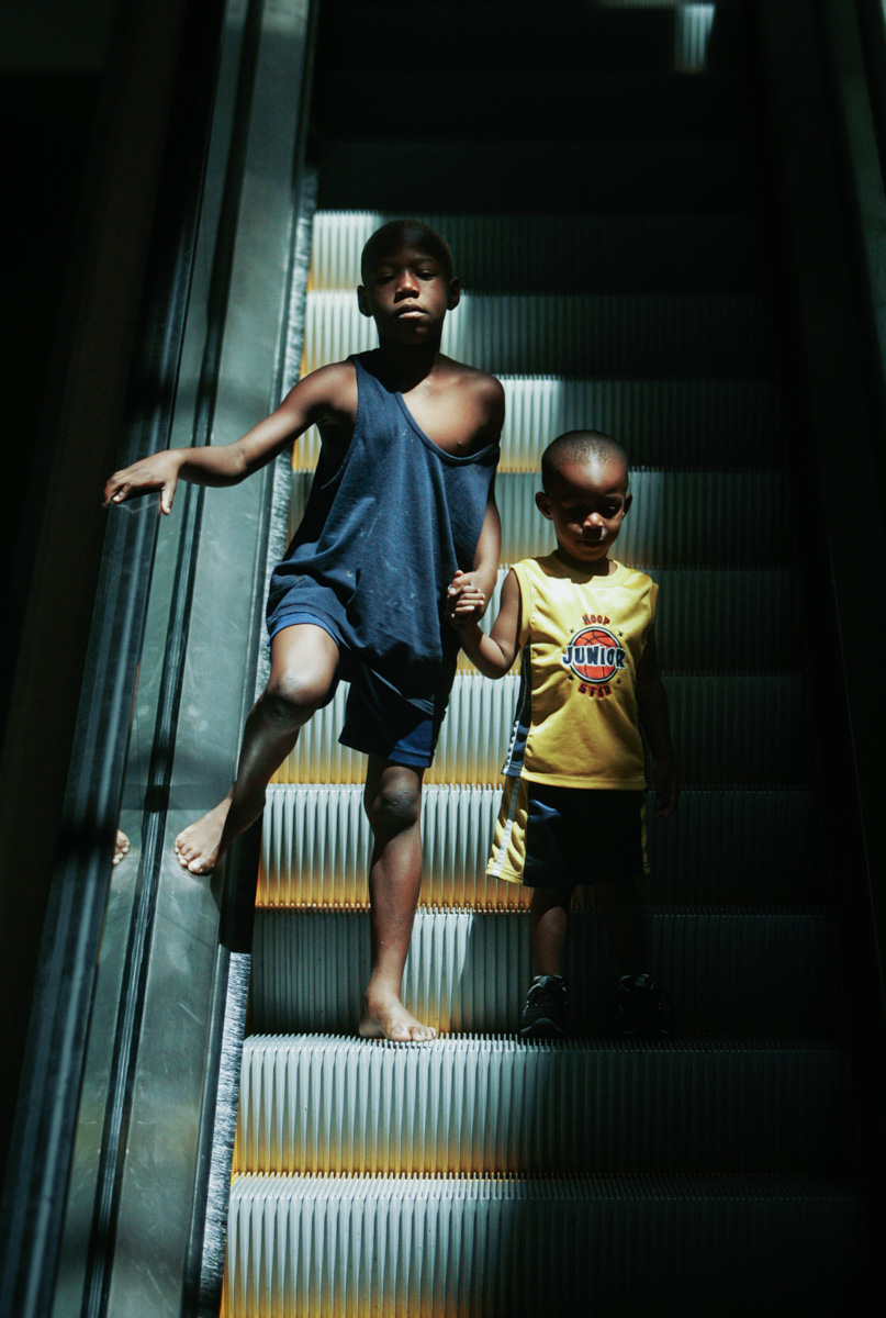 escalator-brothers-hold-hands-1.jpg