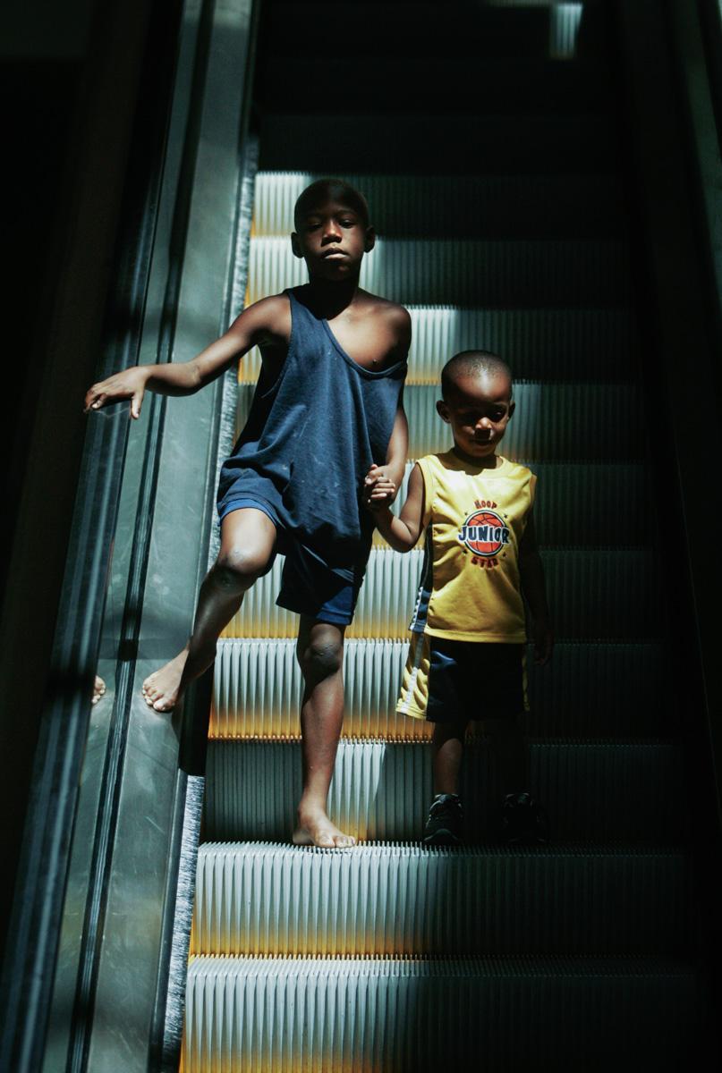 escalator-brothers-hold-hands-1.jpg