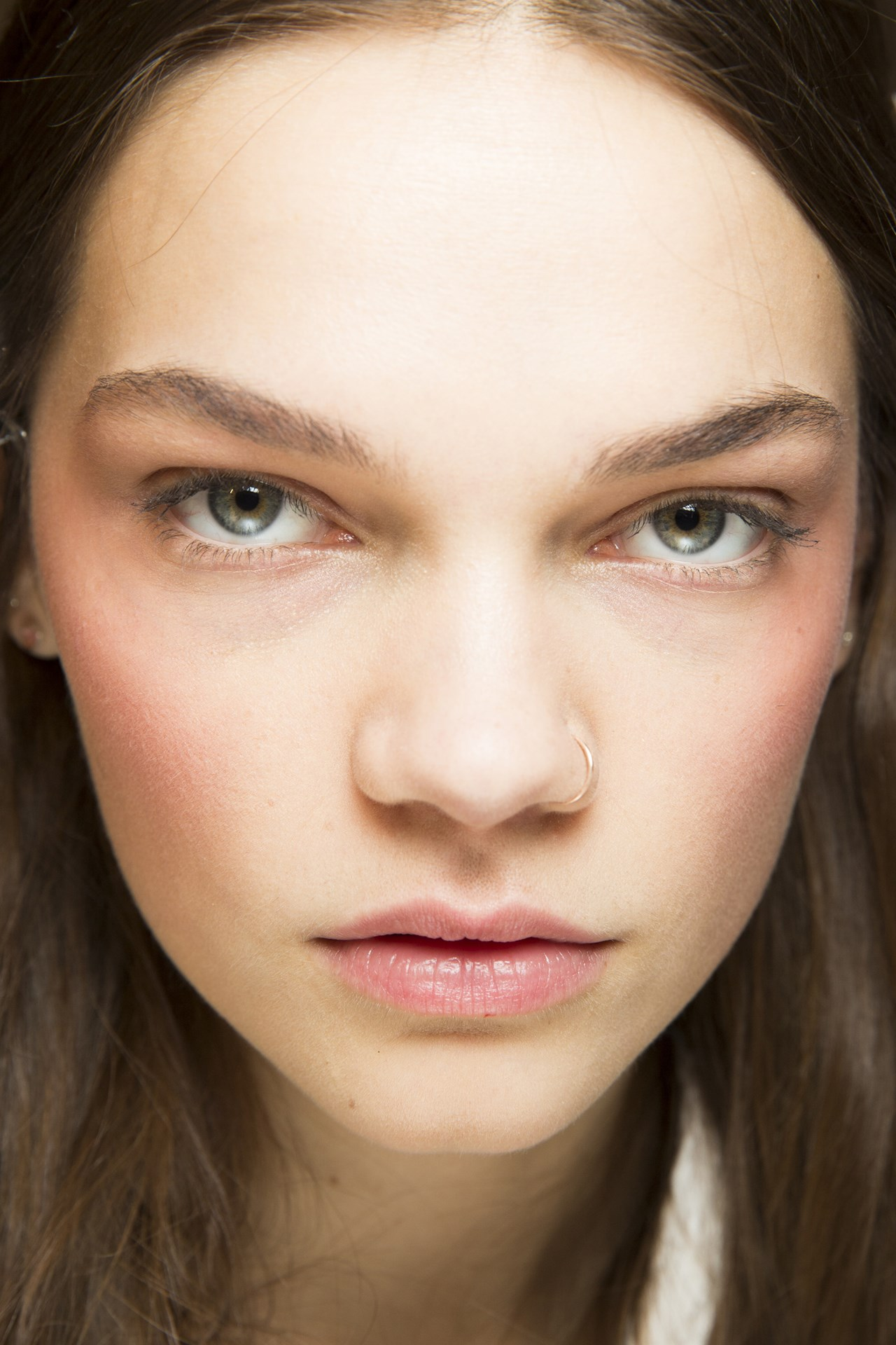 Gucci - Pat McGrath created an ethereal look at Gucci, buffing a coral hue onto the high points of the cheekbones for a new take on blush.