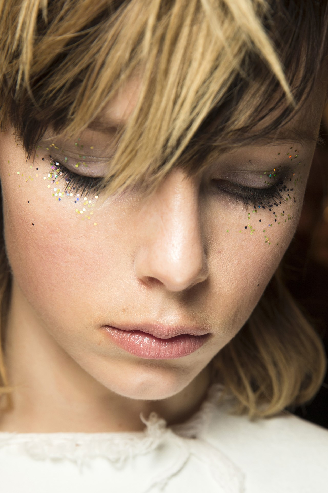 Burberry- At Burberry, Wendy Rowe smudged kohl into the lash line and then diffused glitter from the outer corners of some models' eyes.