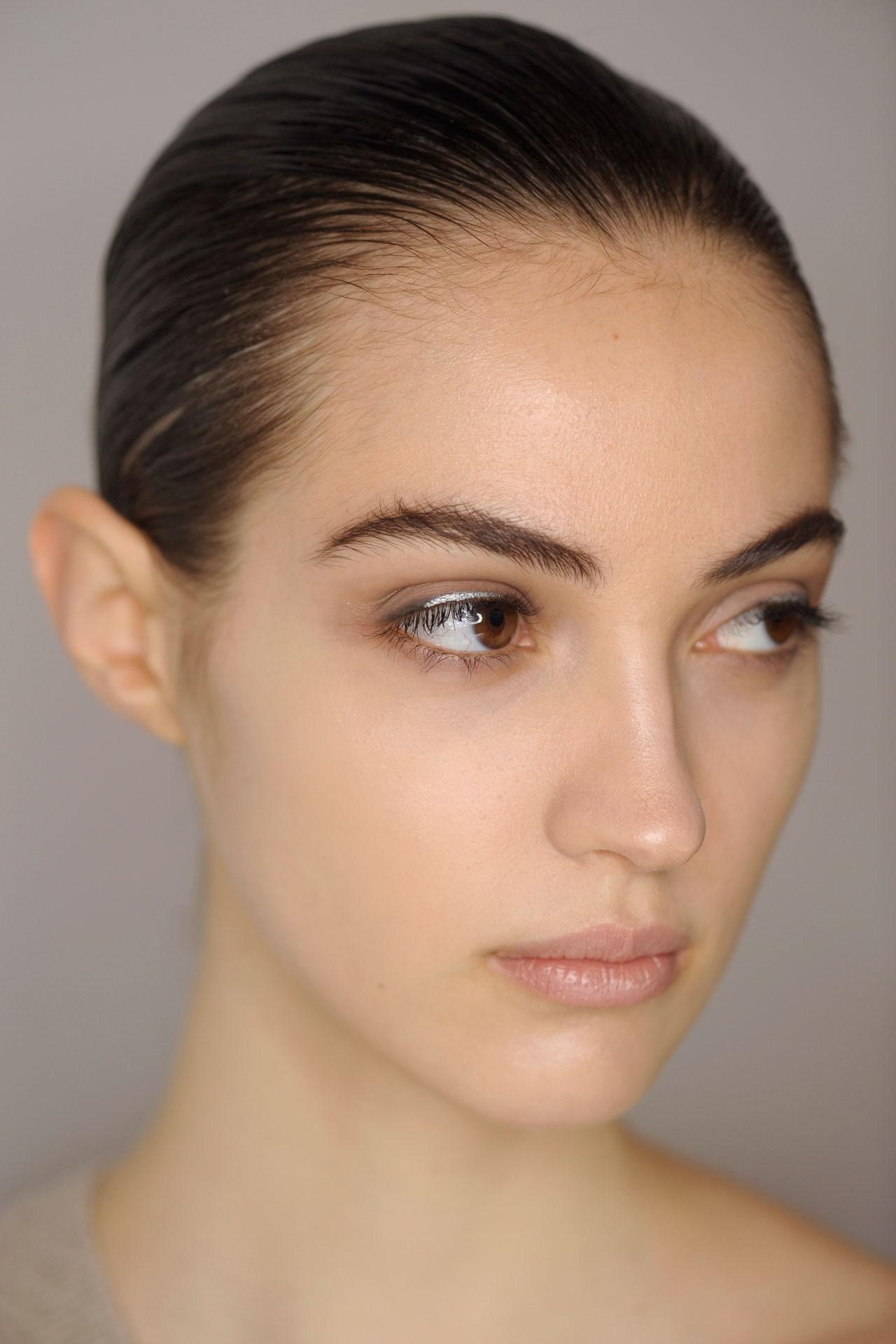 Jil Sander - Lisa Eldridge kept models' skin fresh at Jil Sander, with grey-lined eyes offset by a flash of silver.