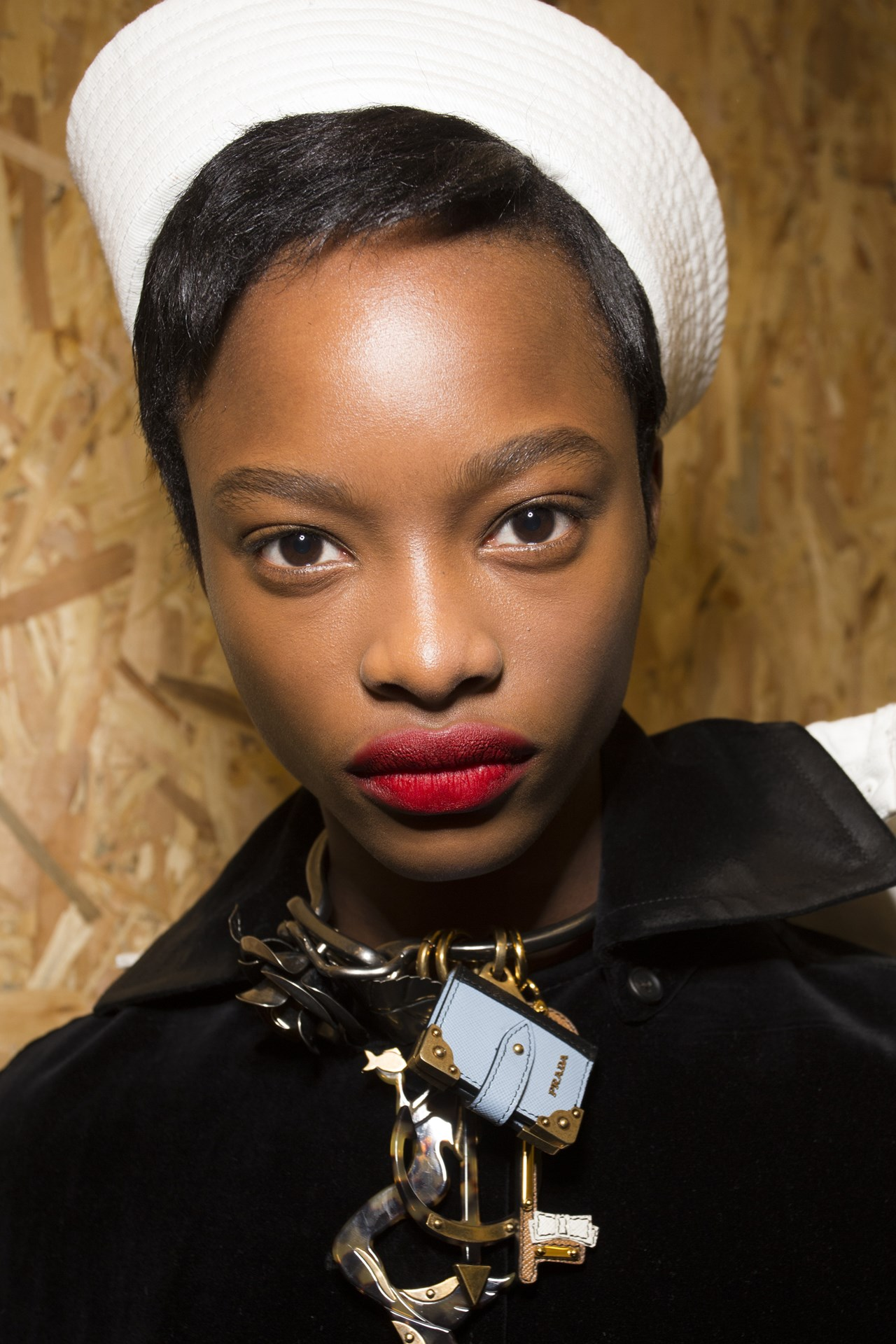 Prada - Matt red lips, groomed brows and fresh skin made up Pat McGrath's beauty look for Prada.