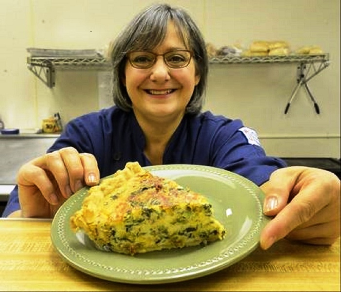 Serving up some quiche at Feast of Eden Cafe!