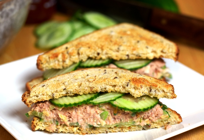 Feast's Asian-Style Tuna Salad served as a sandwich with toasted whole-grain bread and thinly-sliced cucumbers.