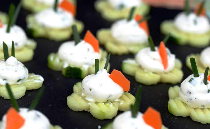 Cucumber Flowers with Herbed Cream Cheese, garnished with carrots and chives