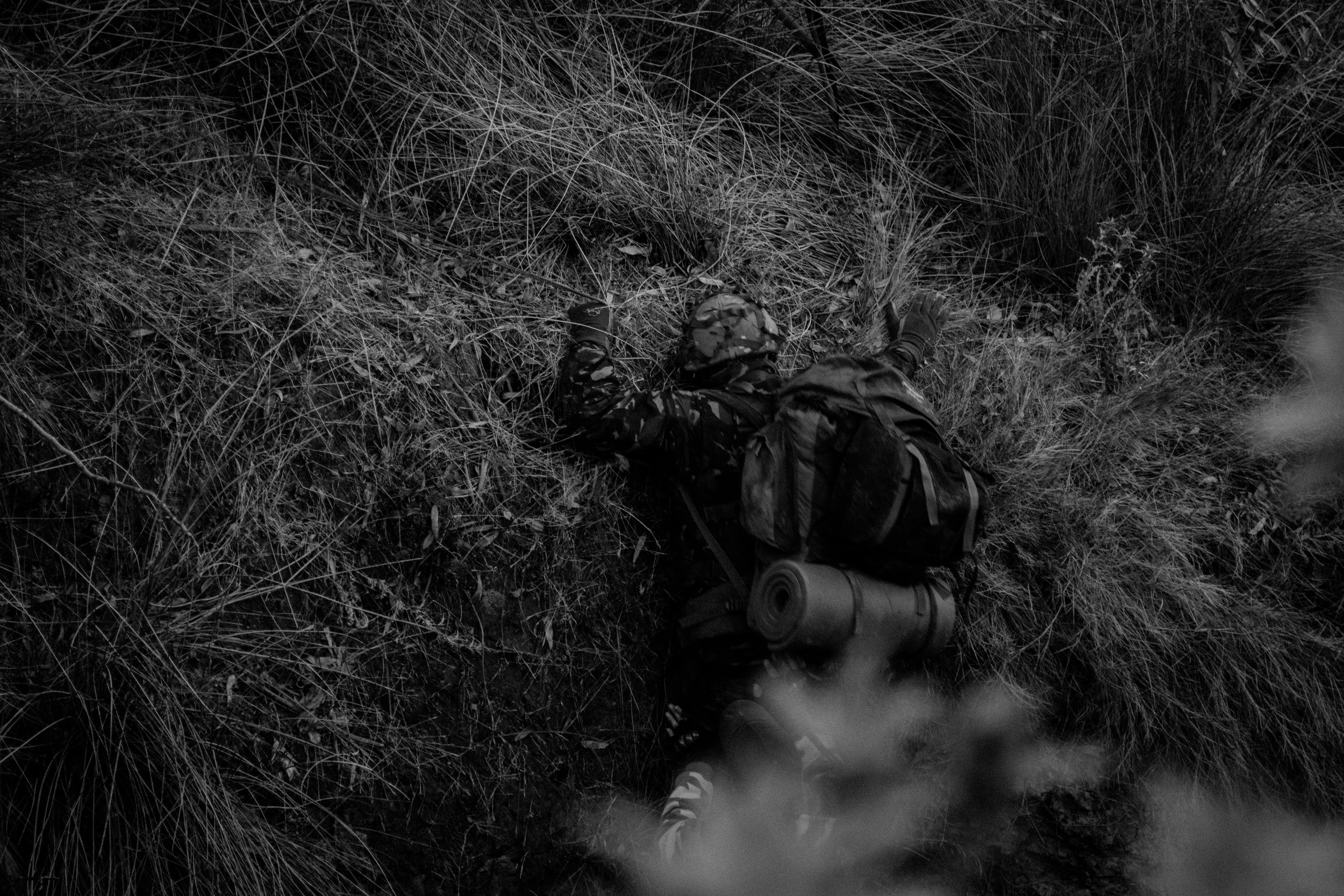 doug, a journalist, is climbing up the ravine