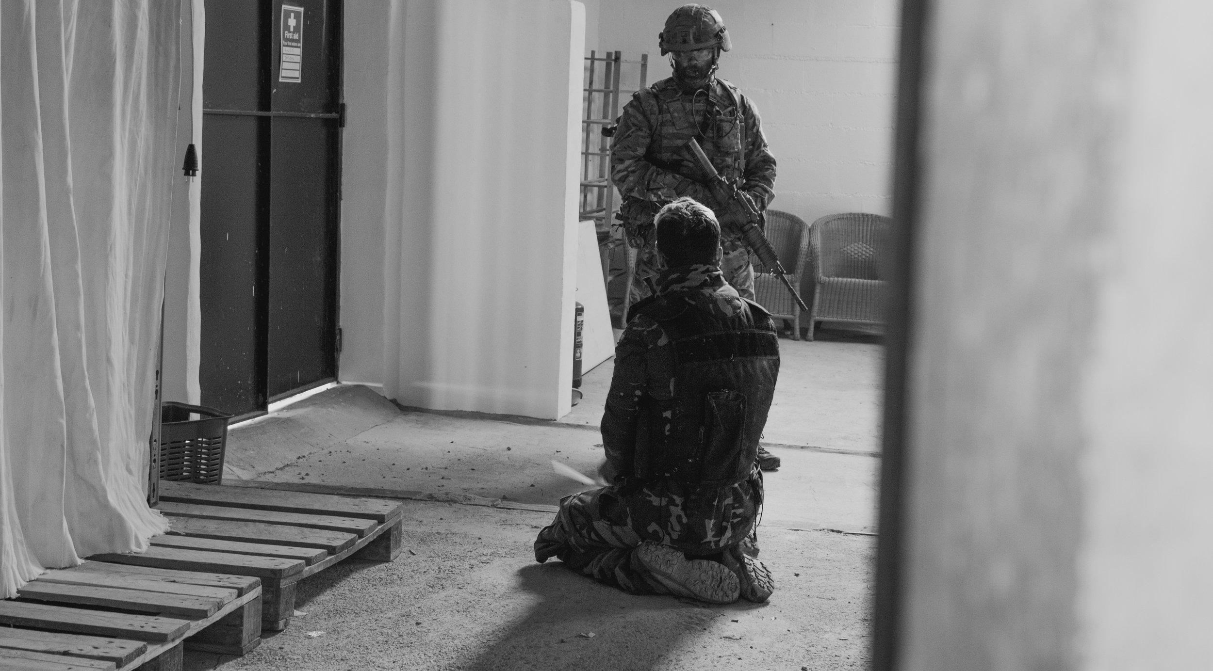 a quiet moment between prisoner and captor