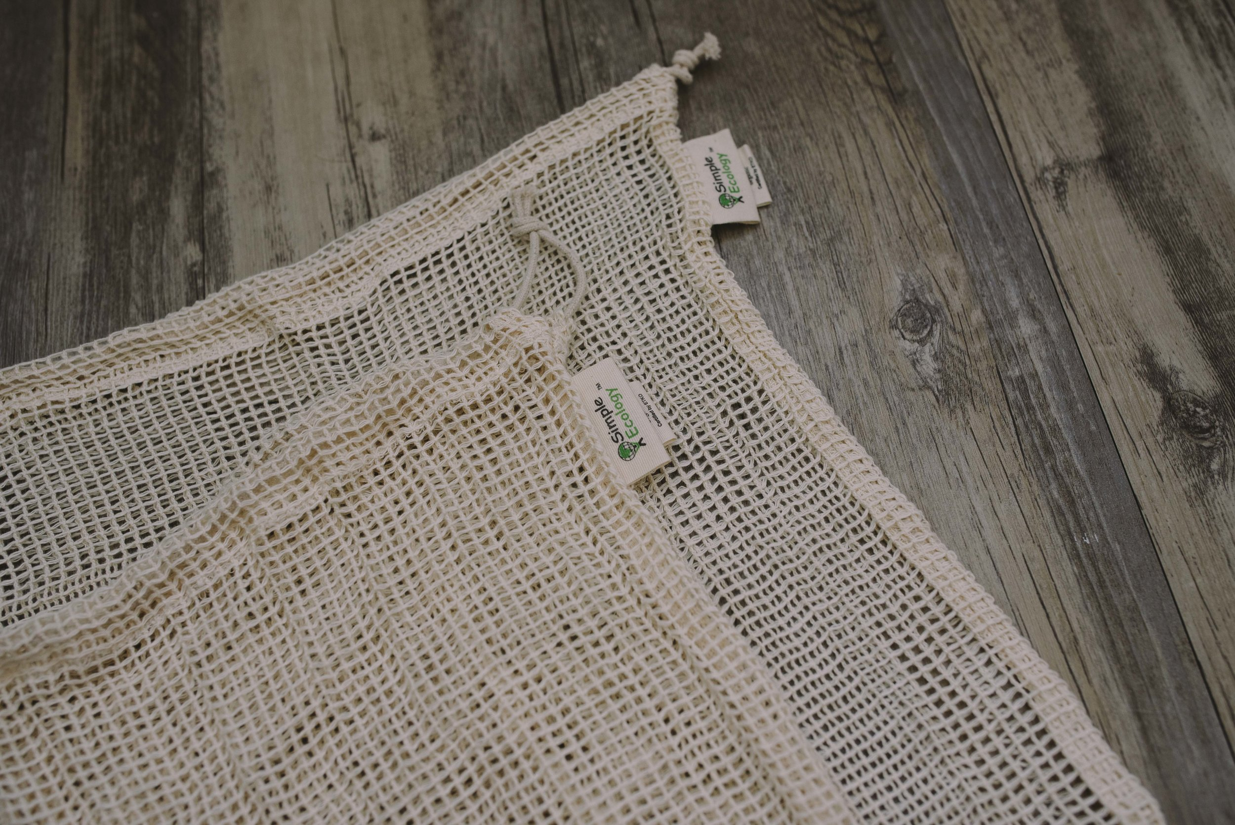 I use  Simple Ecology  produce bags that are made out of organic cotton and are machine washable.