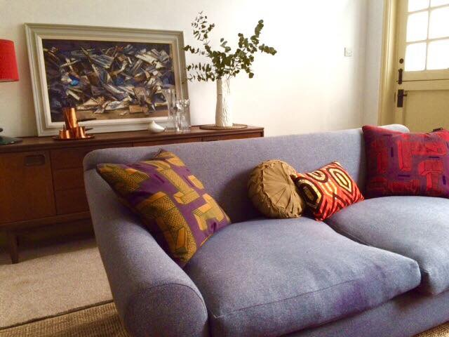 African cushion sitting well in this uber gorgeous sitting room.