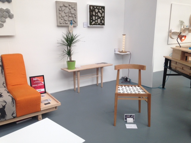 Nottingham Trent University show a selection of furniture, a strong collection of well designed pieces. The entrance bench Noah, in the background is lovely by Temitope Edun, made in white ash is perfect for perching whilst its Nordic inspired minimal design provides a stylish look for any lucky hallway. Temi is certainly a future designer to watch! www.t.edun@hotmail.com  Sitting in the foreground is a wonderful example of a dining chair by Elizabeth Andrews. Experimenting with materials which contrast, she pushes our perception of the norm, American white oak is juxtaposed with white woven Corian ,  providing a very comfortable experience!  elizabethandrews.eaa@gmail.com