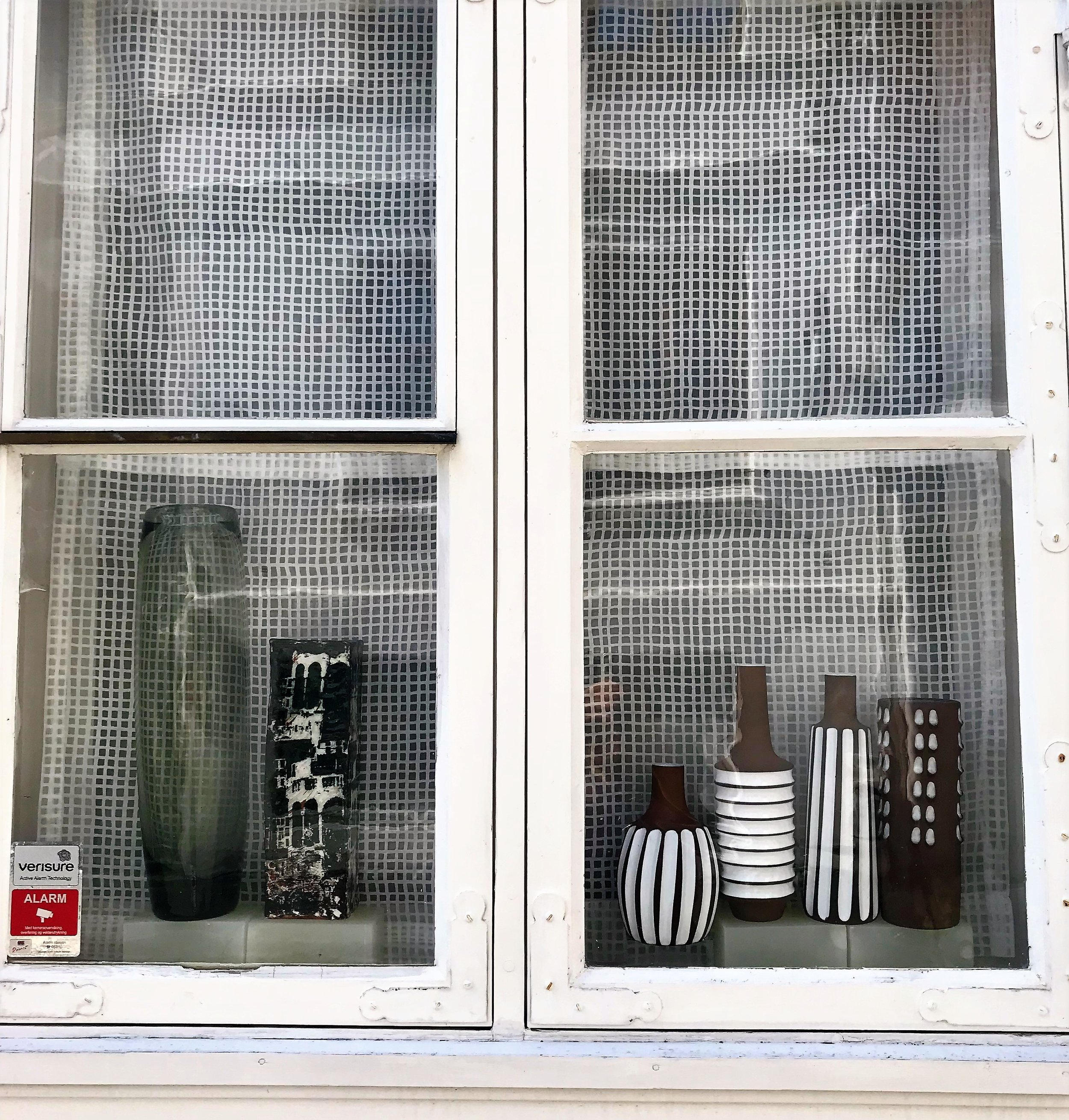 Someones ceramic collection in their front window In Bergen.