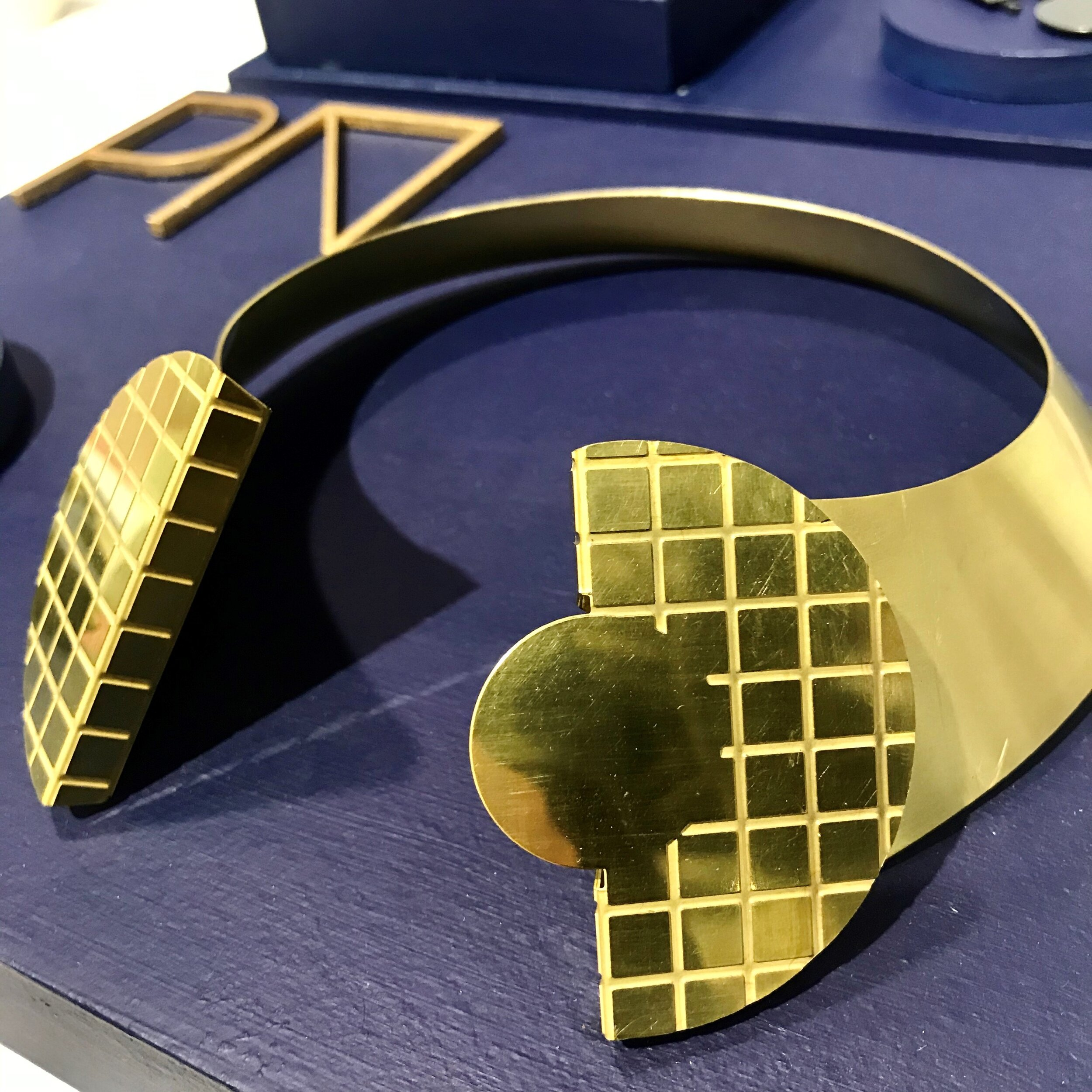 Poppy Norton  - This collection of design led statement jewellery comes in non traditional materials such as brass + lino + acrylic + wood. Taking inspiration from her love and knowledge of product design and architecture the collection carries a strong graphic identity. www.poppynorton.com