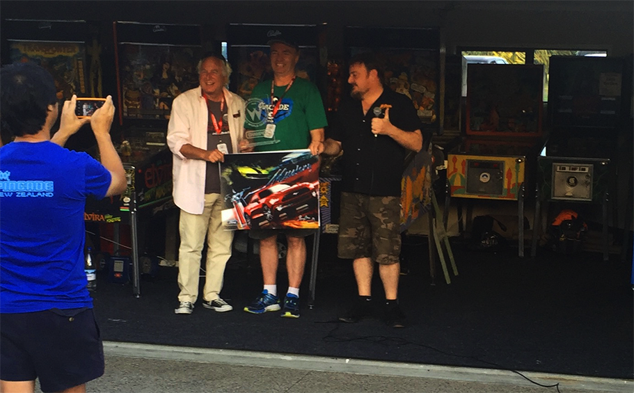 Mark Tibbetts being presented with the grand champion prize for winning the System 11 World Pinball Championship.
