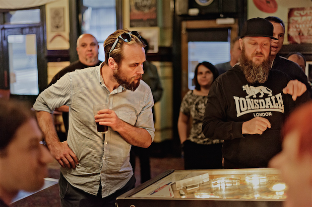 Always one to enjoy the theory of pinball, Tim gets some tips from Mr Z-Ball himself.  Photo by Matthew Venables:  mvenables.com