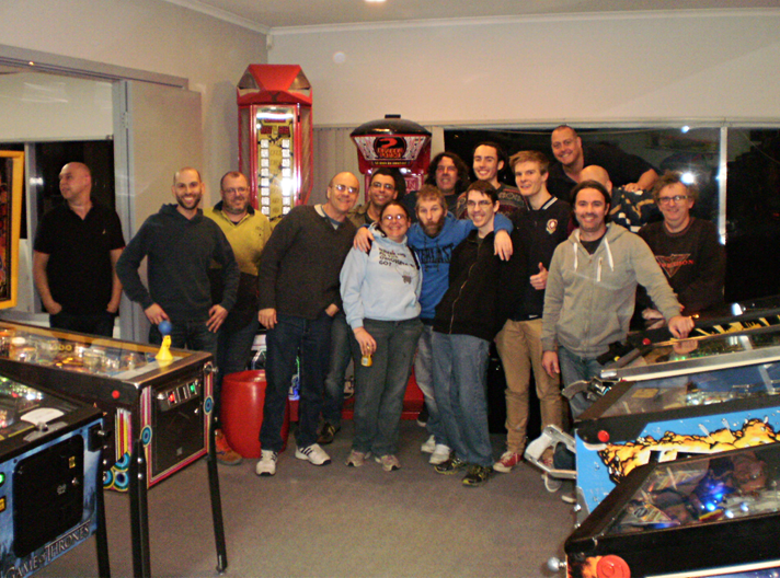At the end of the night this group photo was taken. It includes 13 of the finalists (Chris Craft was an apology &Vincent Rossis had left). From left to right; Stephen Vari (Amusement Worx), Michael Costalos, Robert Macauley (winner), Paul Michell (Tournament Director),George Choimes, Amity Wells (scorer),Wayne White, Tim Freedman,Sean Olley, Matthew Owen (runner-up), Tom Casey,Andrew Heitmann,Lou Martire,Grant Stephens (obscured) and Gary Regan. Photo courtesy Simon Wisbey, Amusement Worx  .