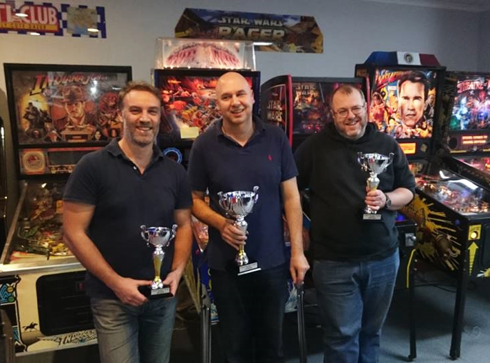 The above picture was taken at the conclusion of the Saturday all-day/night tournament at Amusement Worx in June. The winner Stephen Vari (centre), second place Robert Macauley (right) and third place Evan Lathouras (left). Photo courtesy Simon Wisbey, Amusement Worx  .