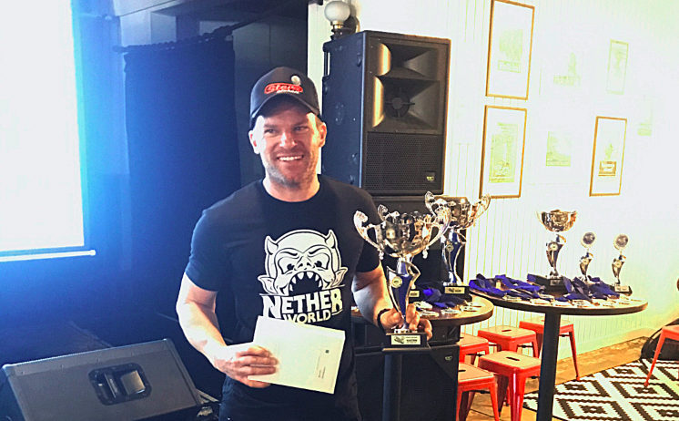 Paul Jones receives the trophy for top qualifier at the Pinball HQ Marathon 2017.
