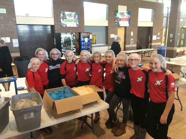 The 12U Red team volunteered in November 2015 to pack meals that were shipped all over the world to aid in Feed My Starving Children's cause.