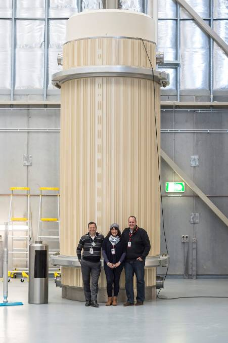 NUCLEAR WASTE: ANSTO chief nuclear officer Hef Griffiths, Michelle Rayner and Brett Rayner with the most radioactive waste on site at Lucas Heights.