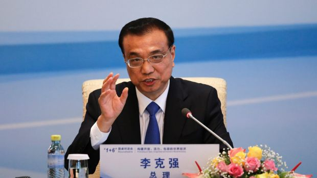 """""""This is a pioneering work in China-U.S. high-tech cooperation, which is on a voluntary basis. This shows the open attitudes of both sides,"""": Chinese Premier Li Keqiang.Photo: AP"""