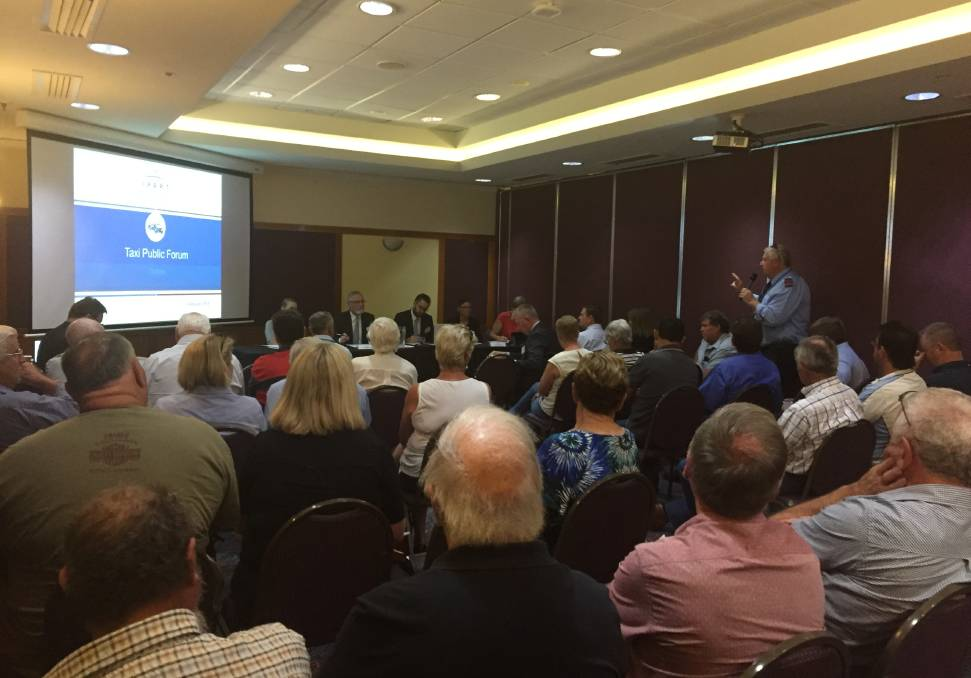Making his case: Dubbo Taxi Co-op chairman Greg Collin addresses a packed room at the IPART hearing into taxi fares and licensing.