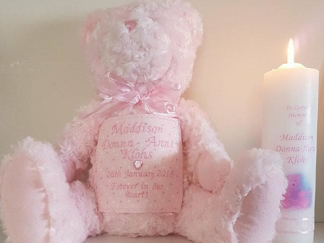 A bear and candle to commemorate Maddison's life. Source:Supplied