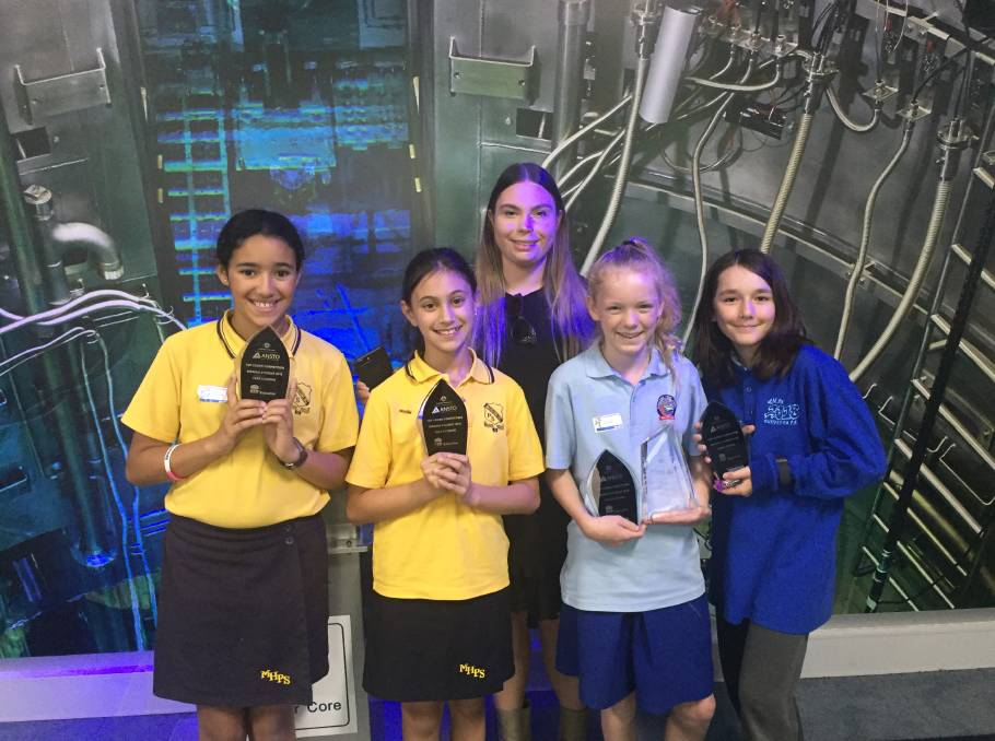 Top coders: Bundeena Public School pupils Zyren Case and Rosa Phelan (pictured far right) with their coding prizes.