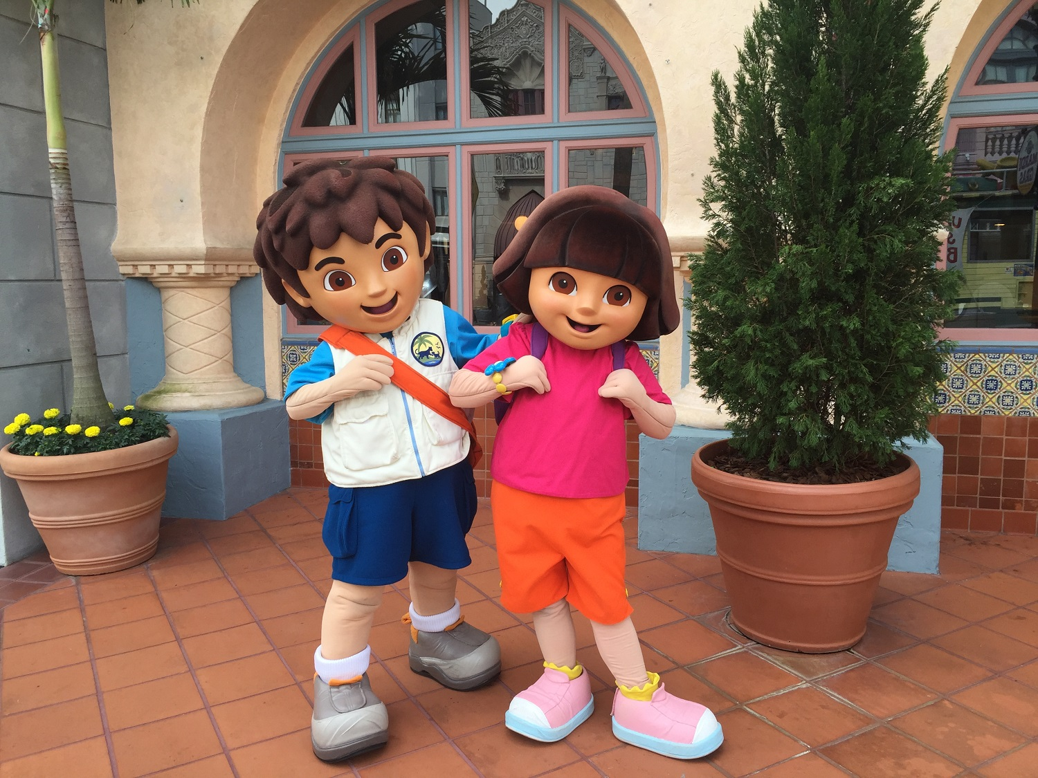 Dora and Diego posing during a meet and greet in Universal Studios Florida.