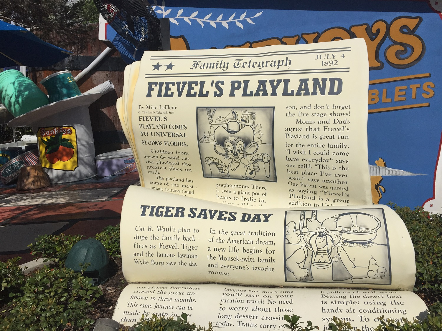 A newspaper announcing Fievel's Playland in Universal Studios Florida at the entrance of the play area.