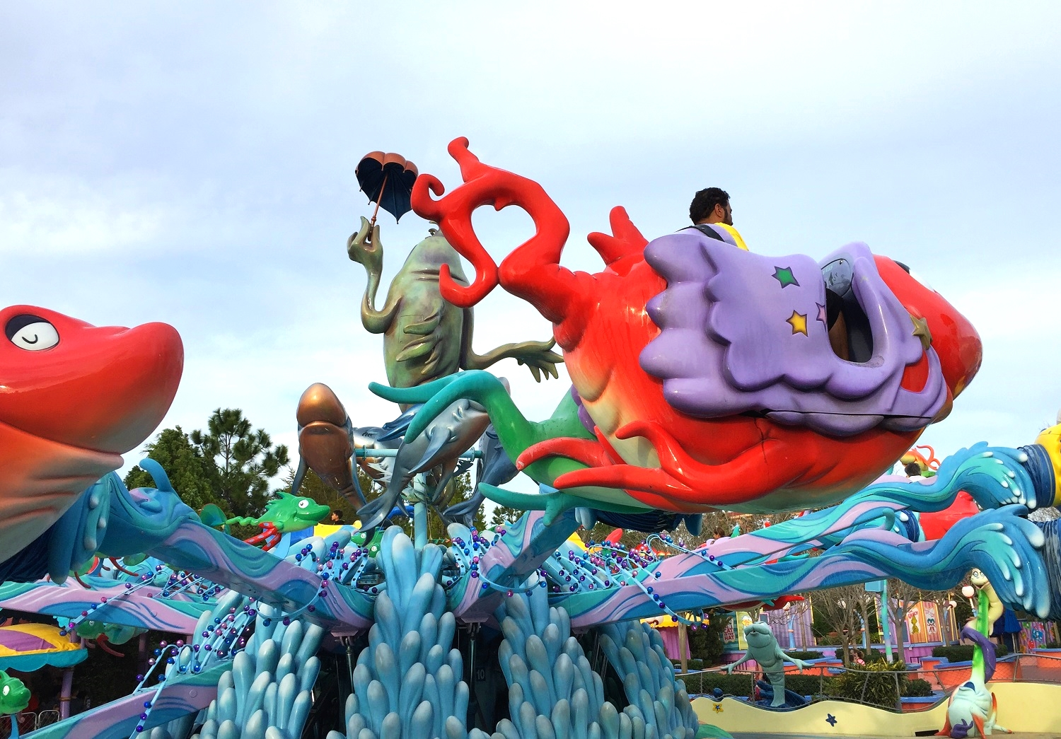 The ride vehicles on One Fish, Two Fish, Red Fish, Blue Fish are shaped like fish.
