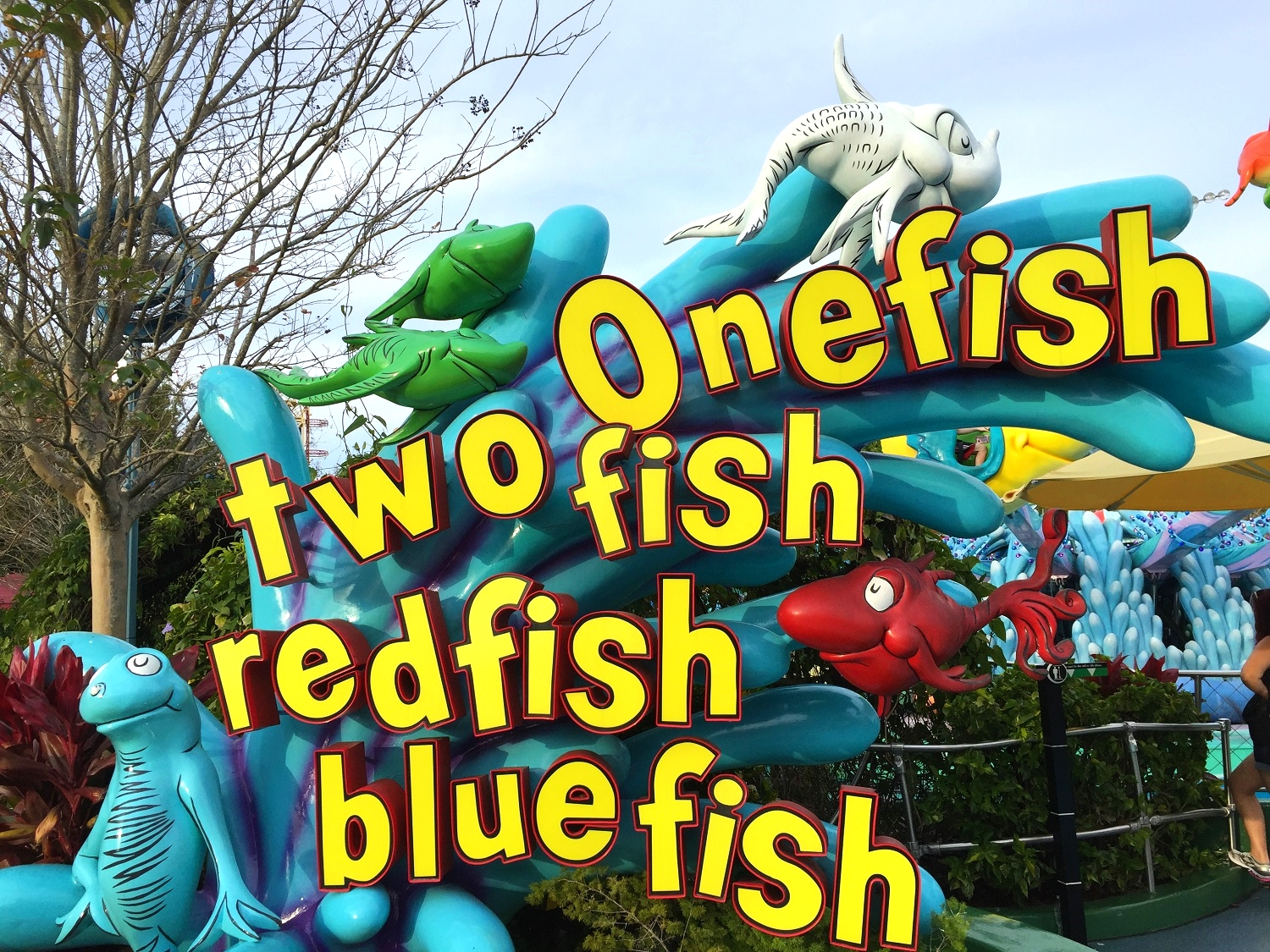 The sign at the ride entrance of One Fish, Two Fish, Red Fish, Blue Fish in Seuss Landing.
