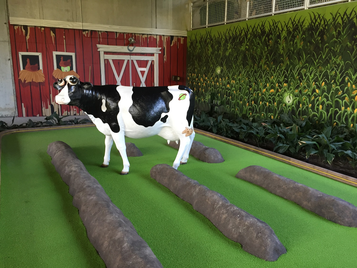 One of the cows in the Invaders from Planet Putt course.