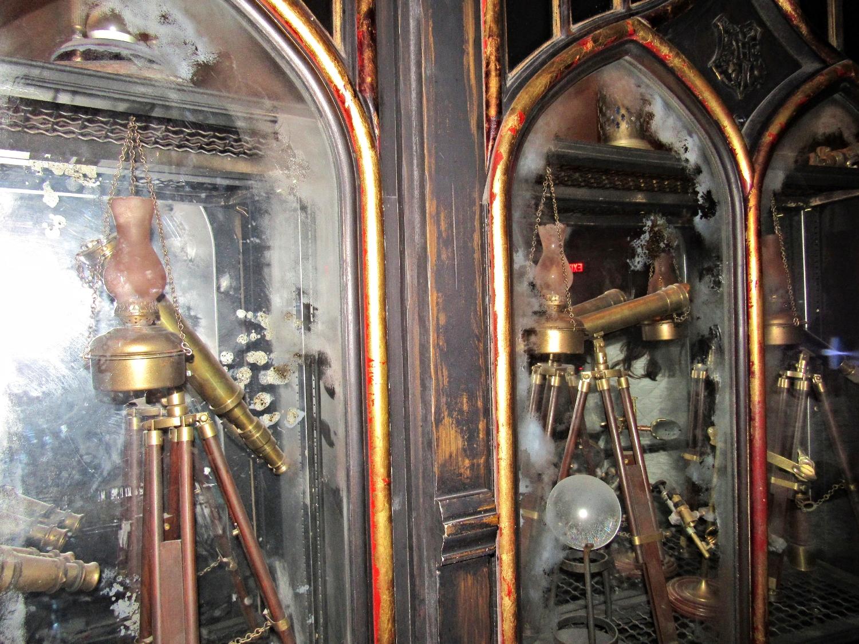 Cases Full of Wizarding Instruments in Dumbledore's Office in Forbidden Journey Queue