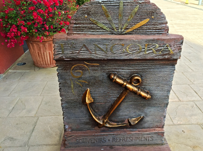 L'Ancora sign in the harbor piazza at Loews Portofino Bay Resort.