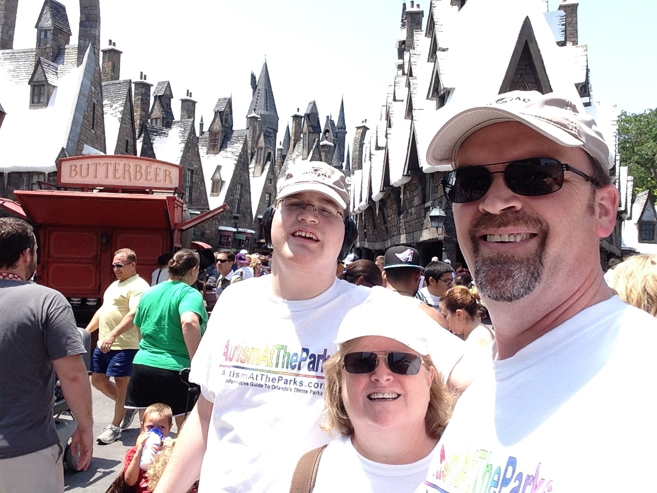 Maureen, Phil, and Zachary in The Wizarding World of Harry Potter - Hogsmeade in Universal Orlando. Copyright AutismAtTheParks.com. All rights reserved.