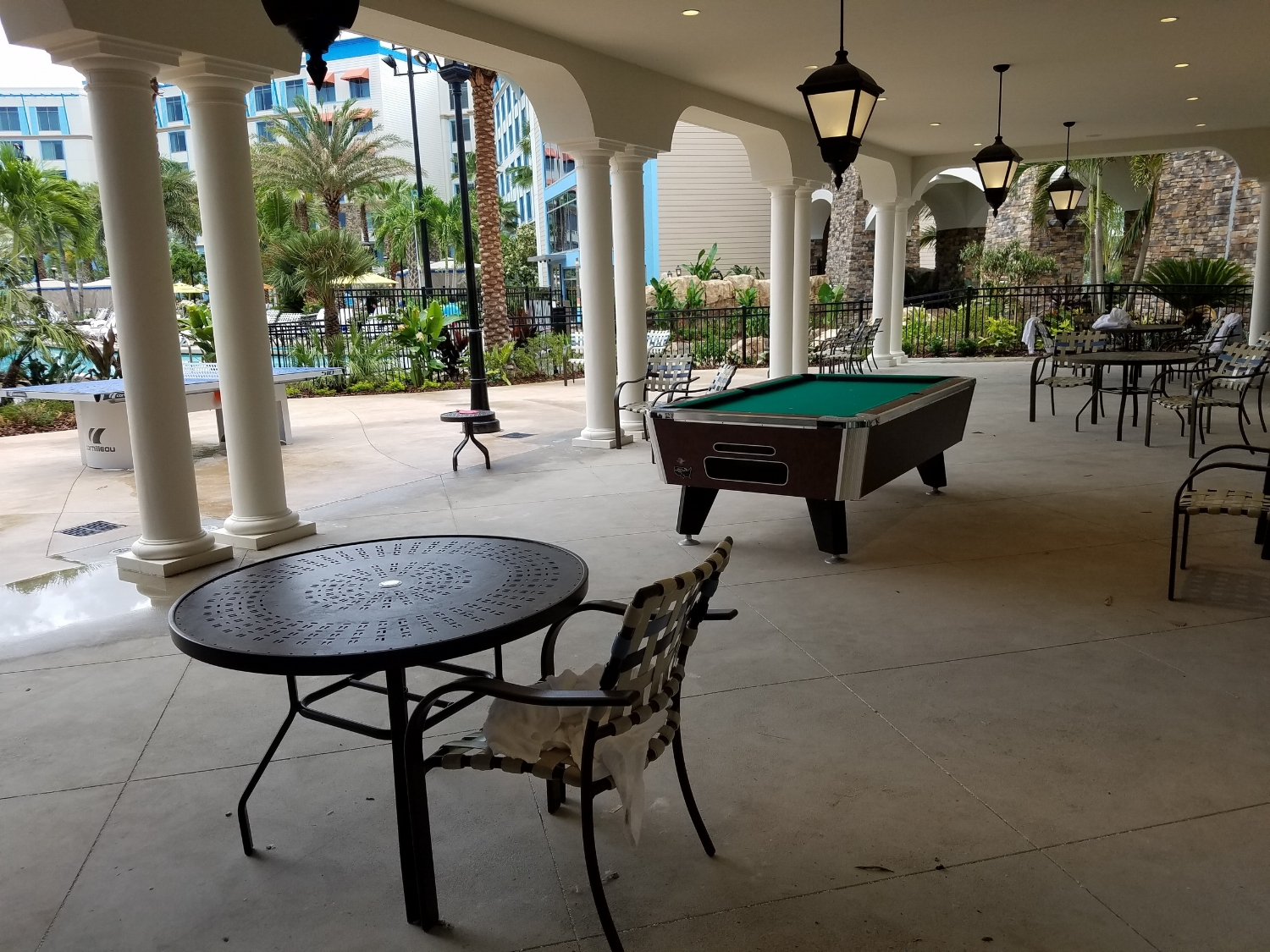 Covered Seating Area Near the Pool at Loews Sapphire Falls Resort
